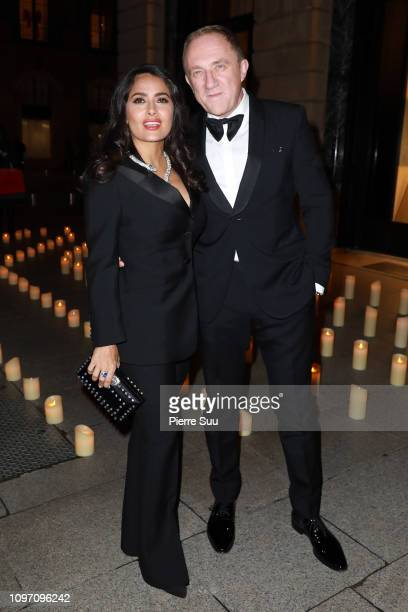 FrançoisHenri Pinault and Salma Hayek arrive at a Boucheron Cocktail Party at the Boucheron Store Place Vendome on January 20 2019 in Paris France