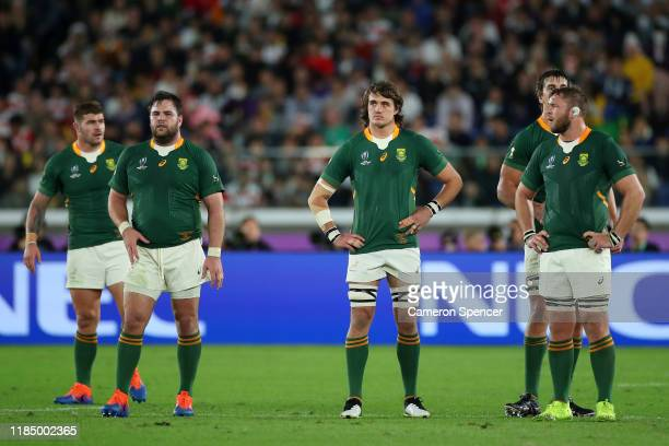 Frans Malherbe Franco Mostert Eben Etzebeth and Duane Vermeulen of South Africa look on during the Rugby World Cup 2019 Final between England and...