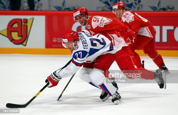 Frans Nielsen of Denmark and Alexei Tereshenko of Russia battle for the puck during the IIHF World Championship group S match between Denmark and...