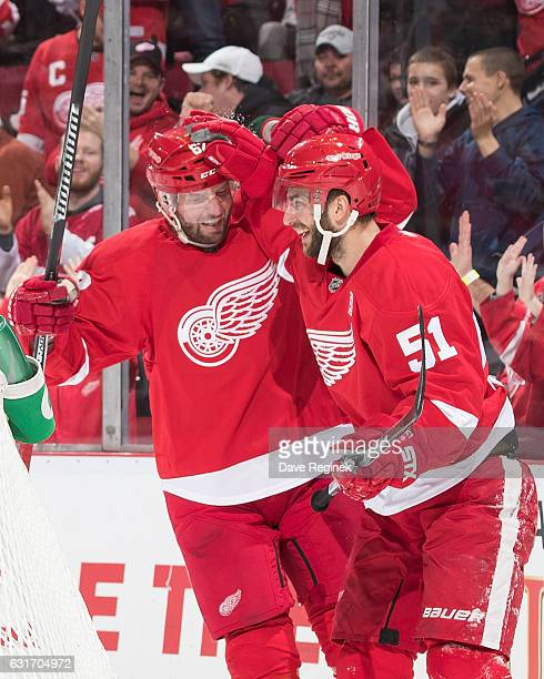 Frans Nielsen of the Detroit Red Wings celebrates his second period goal with teammate Thomas Vanek during an NHL game against the Pittsburgh...