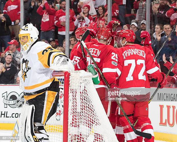 Frans Nielsen of the Detroit Red Wings celebrates his second period goal with teammates in front of goaltender MarcAndre Fleury of the Pittsburgh...