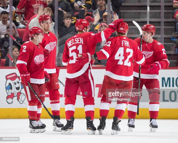 Frans Nielsen of the Detroit Red Wings celebrates his second period goal with teammates Anthony Mantha Joe Hicketts Martin Frk and Dylan Larkin...