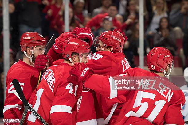 Frans Nielsen of the Detroit Red Wings celebrates with teammates Luke Glendening Mike Green and Danny DeKeyser following his first period goal during...