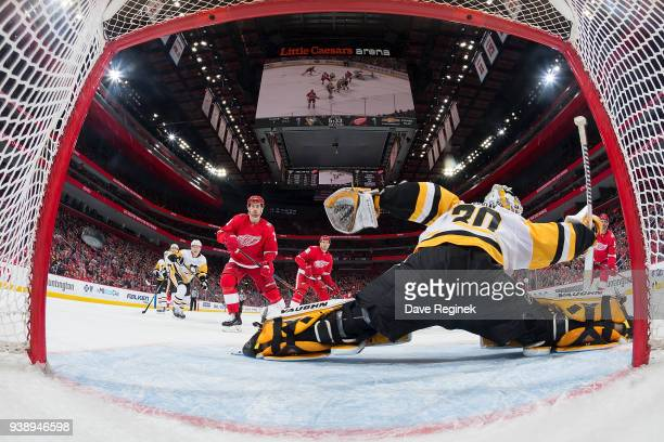 Frans Nielsen of the Detroit Red Wings scores a second period goal past Matt Murray of the Pittsburgh Penguins as teammates Dylan Larkin and Anthony...