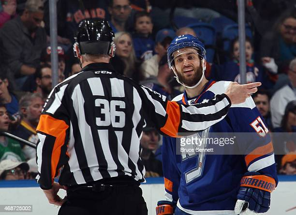 Frans Nielsen of the New York Islanders argues a call with referee Dean Morton during the game against the Buffalo Sabres at the Nassau Veterans...