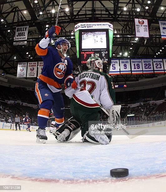 Frans Nielsen of the New York Islanders celebrates a first period goal by Blake Comeau against Niklas Backstrom of the Minnesota Wild at the Nassau...