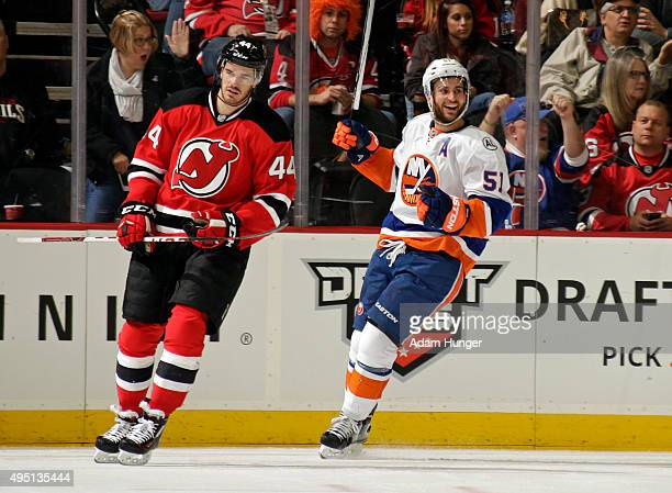 Frans Nielsen of the New York Islanders celebrates scoring a goal as Eric Gelinas of the New Jersey Devils reacts during the second period at the...