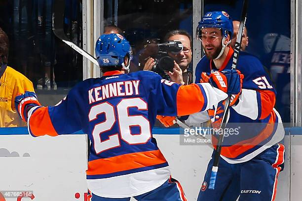Frans Nielsen of the New York Islanders is congratulated by teammate Tyler Kennedy after scoring a second period goal against the Los Angeles Kings...