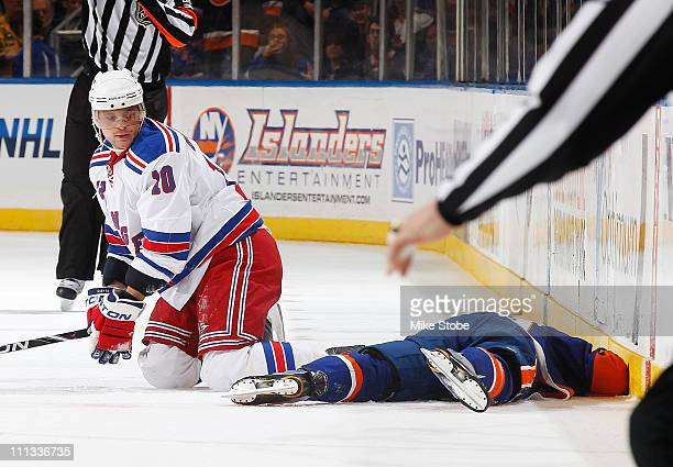 Frans Nielsen of the New York Islanders lays on the ice after a Boarding/Roughing penalty by Marian Gaborik of the New York Rangers on March 31 2011...