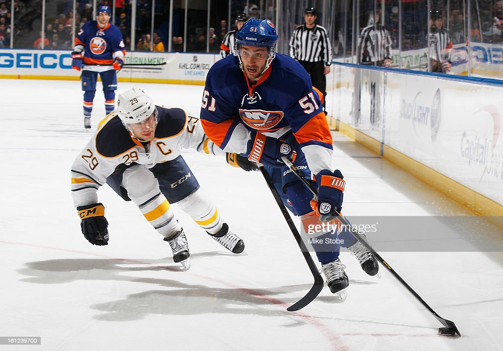 Frans Nielsen #51 of the New York Islanders protects the puck against Jason Pominville #29 of the Buffalo Sabres at Nassau Veterans Memorial Coliseum on February 9, 2013 in Uniondale, New York. The Sabers defeated the Islanders 3-2.