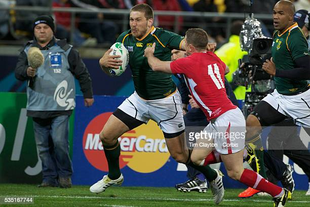 Frans Steyn South Africa holds off the challenge of Shane Williams to score a try during the Wales V South Africa Pool D match during the Rugby World...