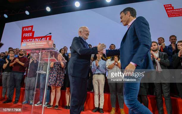 Frans Timmerman PES Common Candidate Designate to preside European Commission is congratulated by Prime Minister of Spain Pedro Sanchez at the end of...