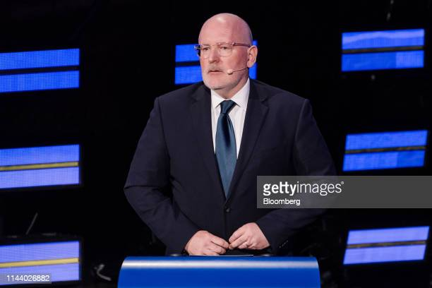 Frans Timmermans lead candidate of the Party of European Socialists stands at a podium ahead of a European Commission presidential candidate debate...