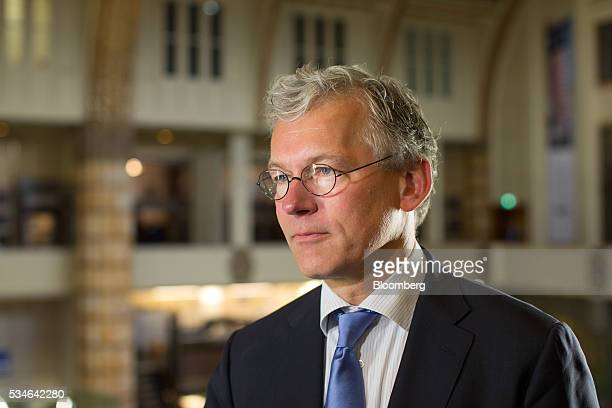 Frans van Houten chief executive officer of Royal Philips NV pauses during an interview after the Philips Lightning NV debut at Amsterdam Stock...