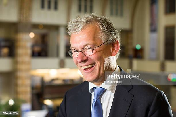 Frans van Houten chief executive officer of Royal Philips NV reacts during an interview after the Philips Lightning NV debut at Amsterdam Stock...