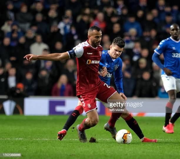 Fransergio of Braga and Ianis Hagi of Rangers during the UEFA Europa League round of 32 first leg match between Rangers FC and Sporting Braga at...