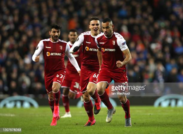 Fransergio of Braga celebrates after socring his teams first goal during the UEFA Europa League round of 32 first leg match between Rangers FC and...