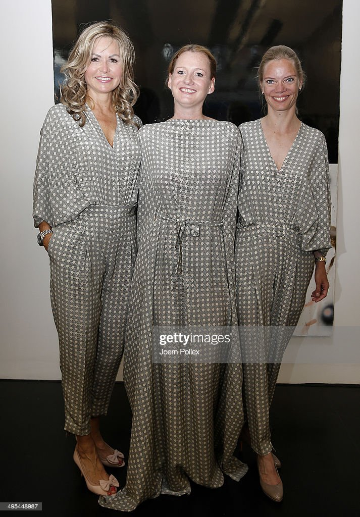 Fransiska Hirsch (L), Jenny Falckenberg (C) and Katharina Lube are pictured during the 'Dawid Tomaszewki Pop-Up Store Opening' on June 3, 2014 in Hamburg, Germany.