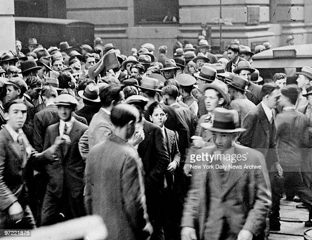 A frantic crowd buying newspapers in front of the New York Stock Exchange on Broad Street to find out information on the unstable market