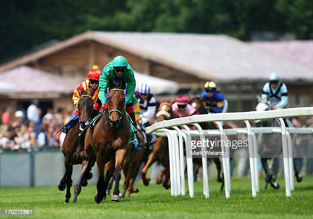 Frantic Storm ridden by Andreas Helfenbeinon leads the field into the first turn in the Preis der Lotterie Spiel 77 during the Lotto Festival 2013 at...