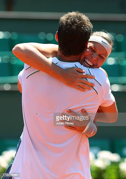 Frantisek Cermak and Lucie Hradecka of Czech Republic celebrate match point in their mixed doubles final against Kristina Mladenovic of France and...