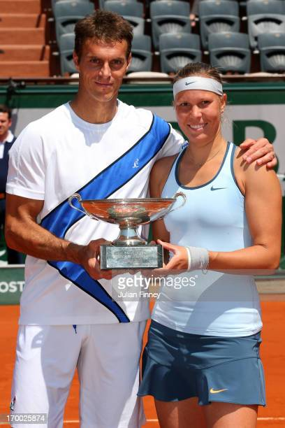 Frantisek Cermak and Lucie Hradecka of Czech Republic pose with the trophy after victory in their mixed doubles final against Kristina Mladenovic of...