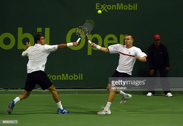 Frantisek Cermak and Michal Mertinak in action against Steve Darcis and Lukasz Kubot during the 2nd round of the ATP Qatar ExxonMobil Open at the...