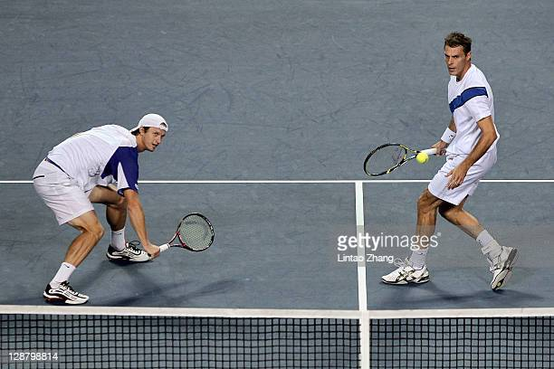 Frantisek Cermak of Czech Republic and Filip Polasek of Slovakia return a shot to Andy Murray with Jamie Murray of Great Britain in man doubles final...