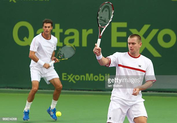 Frantisek Cermak of Czech Republic and Michal Mertinak of Slovakia in action against Evgeny Korolev of Russia and Sergiy Stakhovsky of Ukraine during...
