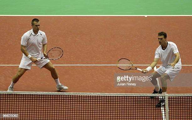 Frantisek Cermak of Czech Republic and Michal Mertinak of Slovakia in action in their doubles match against Michael Llodra of France and Andy Ram...