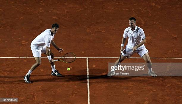 Frantisek Cermak of Czech Republic and Michal Mertinak of Slovakia in action in their doubles match against Bob and Mike Bryan of USA during day four...