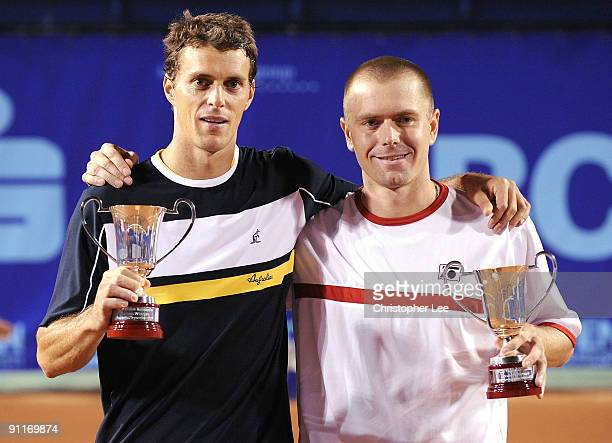 Frantisek Cermak of Czech Republic and Michal Mertinak of Slovakia pose for the camera's with their Winners Trophies after beating Johan Brunstrom of...