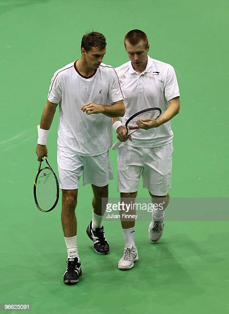 Frantisek Cermak of Czech Republic and Michal Mertinak of Slovakia talk tactics in their doubles match against Michael Llodra of France and Andy Ram...