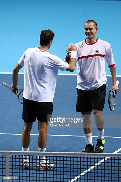 Frantisek Cermak of Czech Republic celebrates with Michal Mertinak of Slovakia after they won the men's doubles second round match against Daniel...