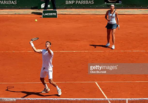 Frantisek Cermak of Czech Republic plays a forehand next to team-mate Lucie Hradecka in their mixed doubles final against Kristina Mladenovic of...