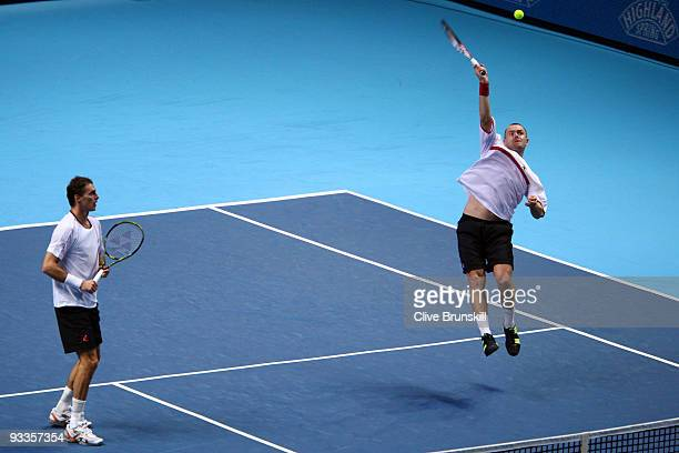 Frantisek Cermak of Czech Republic plays with Michal Mertinak of Slovakia during the men's doubles second round match against Daniel Nestor of Canada...