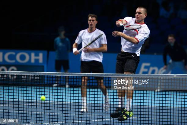 Frantisek Cermak of Czech Republic plays with Michal Mertinak of Slovakia during the men's doubles semi final match against Max Mirnyi of Belarus and...
