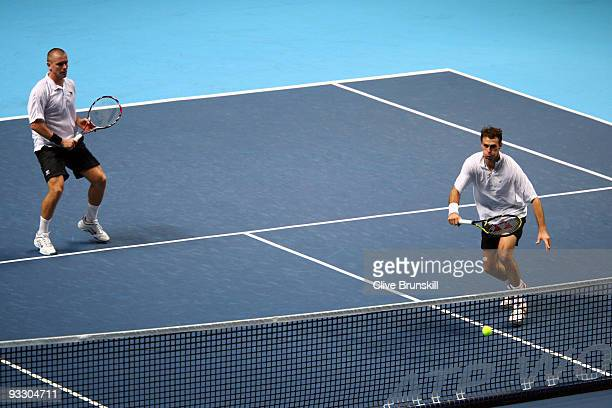 Frantisek Cermak of Czech Republic returns the ball playing with Michal Mertinak of Slovakia during the men's doubles first round match against...