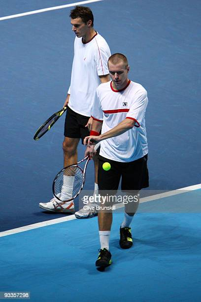 Frantisek Cermak of Czech Republic walks next to Michal Mertinak of Slovakia after they won the men's doubles second round match against Daniel...