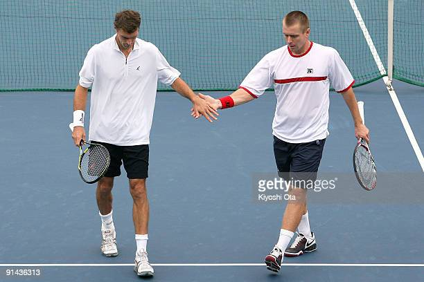 Frantisek Cermak of the Czech Republic and Michal Mertinak of Slovakia celebrate a point in their doubles match against Andreas Beck and Philipp...