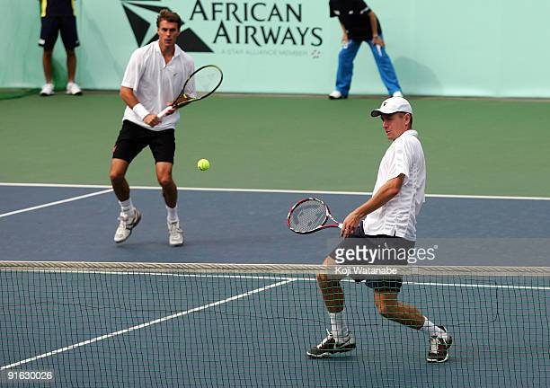 Frantisek Cermak of the Czech Republic and Michal Mertinak of Slovakia returns a shot in their doubles match against Christopher Kas of Germany and...