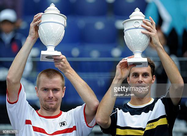 Frantisek Cermak of the Czech Republic and Michal Mertinak of Slovakia hold their trophies aloft during the doubles final of the ATP 500 World Tour...