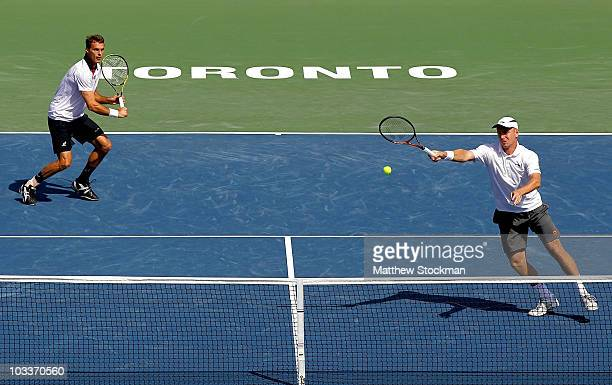 Frantisek Cermak of the Czech Republic and Michal Mertinak of Slovakia play Nenad Zimonjic of Serbia and Daniel Nestor of Canada during the Rogers...