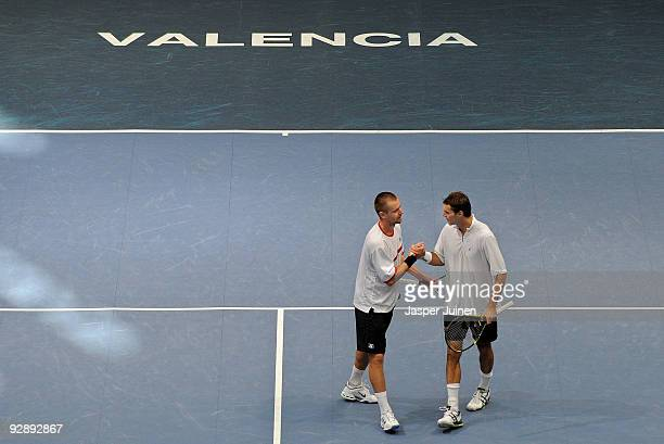 Frantisek Cermak of the Czech Republic and Michal Mertinak of Slovakia celebrate their win over Marcel Granollers and Tommy Robredo of Spain during...
