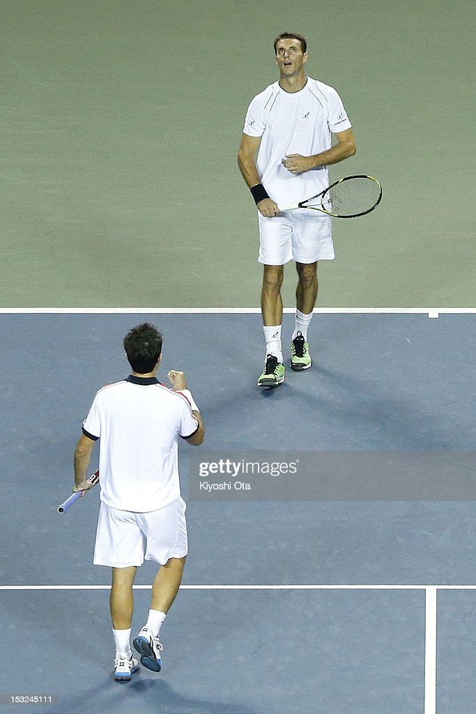 Frantisek Cermak (R) of the Czech Republic celebrate with his team-mate Daniele Bracciali of Italy as they win their first round doubles match against Yuichi Sugita and Yasutaka Uchiyama of Japan during day two of the Rakuten Open at Ariake Colosseum on October 2, 2012 in Tokyo, Japan.