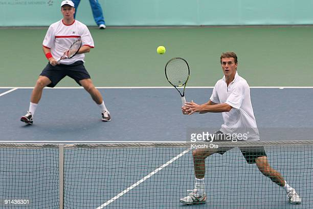 Frantisek Cermak of the Czech Republic returns a shot with his partner Michal Mertinak of Slovakia in their doubles match against Andreas Beck and...