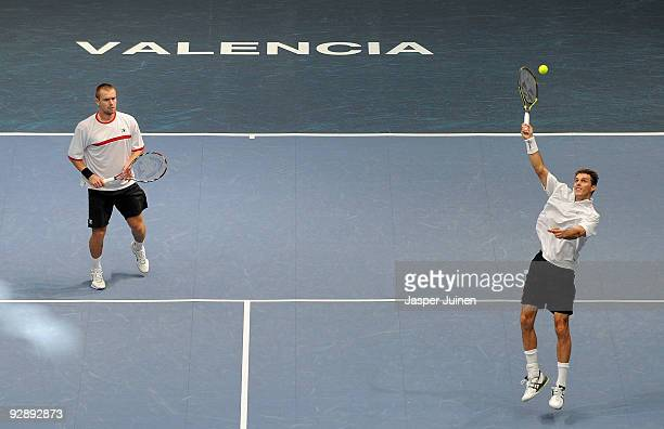 Frantisek Cermak of the Czech Republic smashes the ball flanked by his doubles partner Michal Mertinak of Slovakia to Marcel Granollers and Tommy...