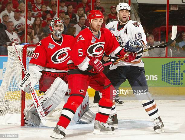 Frantisek Kaberle of the Carolina Hurricanes battles for position with Ethan Moreau of the Edmonton Oilers during the fiirst period of game two of...