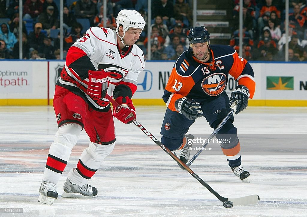 Frantisek Kaberle #5 of the Carolina Hurricanes controls the puck as Bill Guerin #13 of the New York Islanders pressures the play during their NHL game on January 21, 2008 at Nassau Coliseum in Uniondale, New York. The Hurricanes defeated the Islanders 3-2 in overtime.
