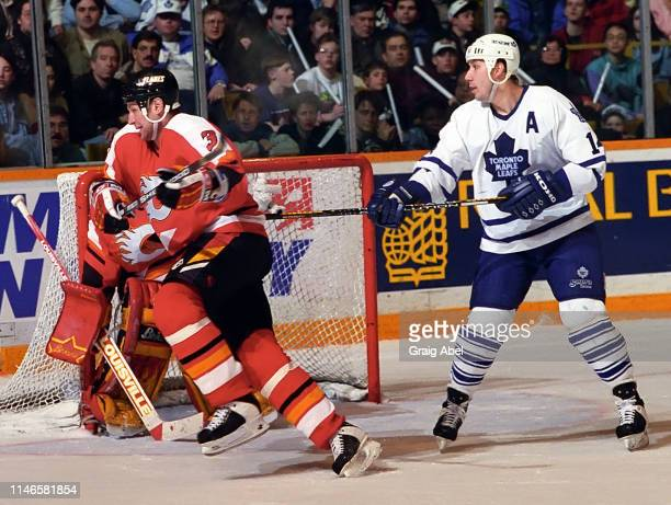 Frantisek Musil of the Calgary Flames skates against Dave Andreychuk of the Toronto Maple Leafs during NHL game action on March 4 1995 at Maple Leaf...